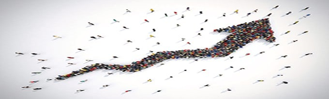 Crowds Of People Form An Arrow Going Upwards